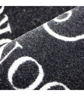 Detail of the modern black and white doormat with non-slip