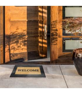 Outdoor doormat with welcome lettering